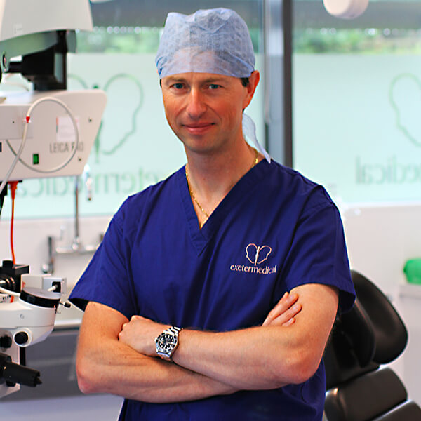 Mr Christopher Stone Consultant Reconstructive & Aesthetic Plastic Surgeon with scrubs in Theatre